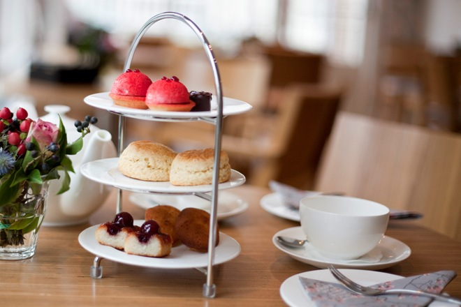 high tea High tea definition: a light meal eaten in the late afternoon or early evening that usually includes cooked food, cakes, and tea to drink learn more.